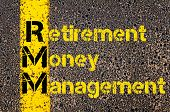 Concept image of Accounting Business Acronym RMM Retirement Money Management written over road marking yellow paint line. poster
