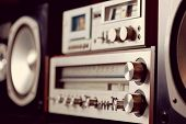 Vintage audio stereo rack with cassette tape deck receiver and speaker, angled view poster