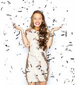 people, holidays, emotion and glamour concept - happy young woman or teen girl in fancy dress with sequins and confetti at party poster