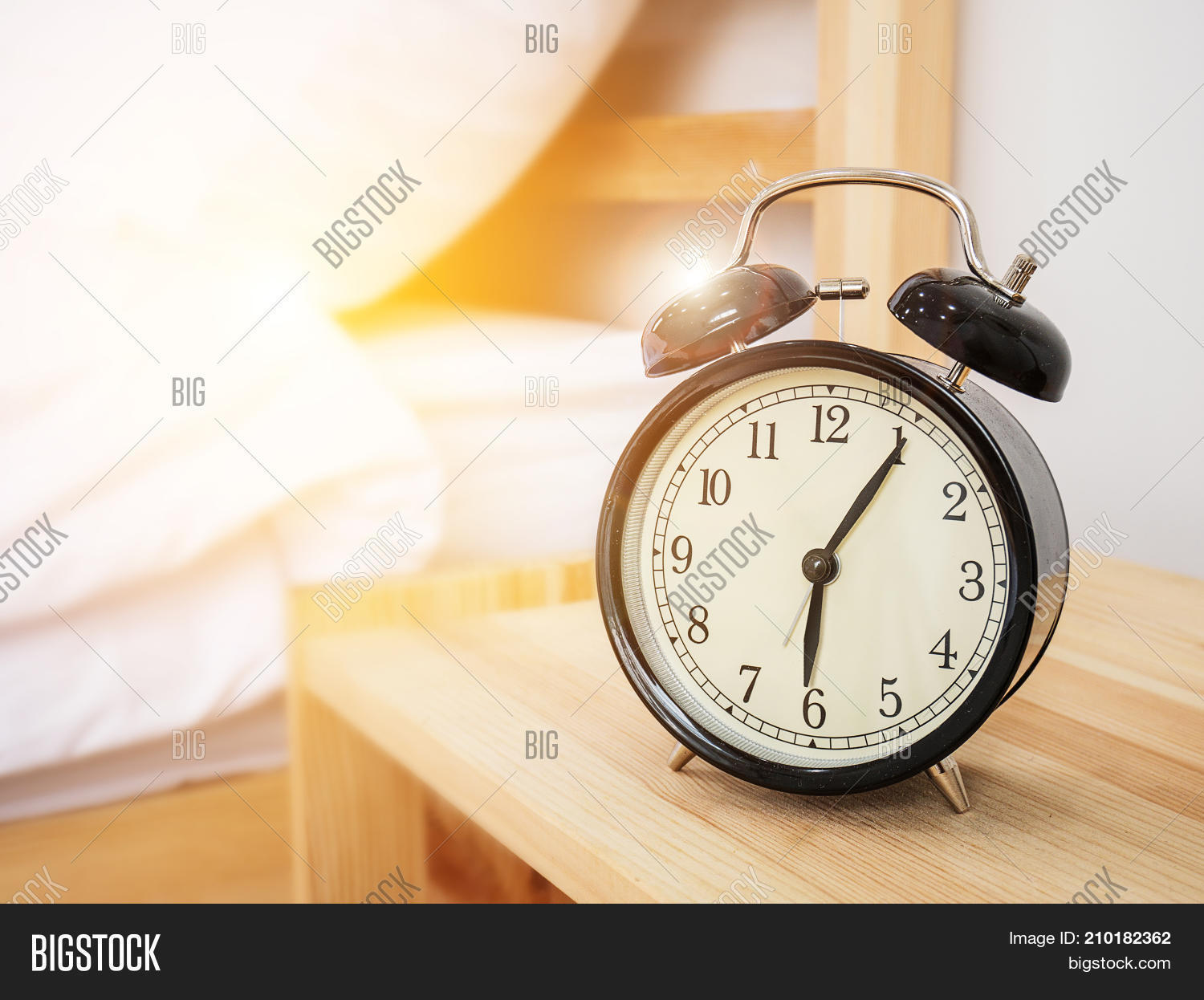 alarm clock wake up time concept retro alarm clock with five minutes past six