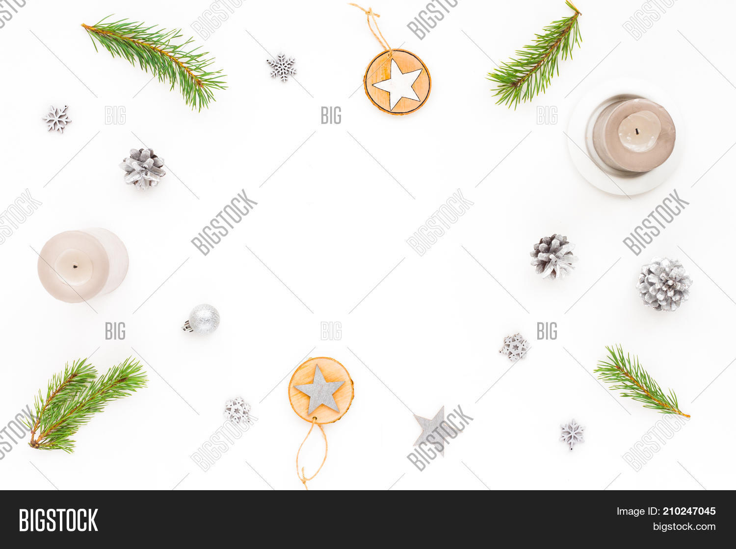 99d70244907d Christmas frame. Grey candles pine branches wood slice christmas decoration  silver pine cone stars snowflake on white background flat lay top view