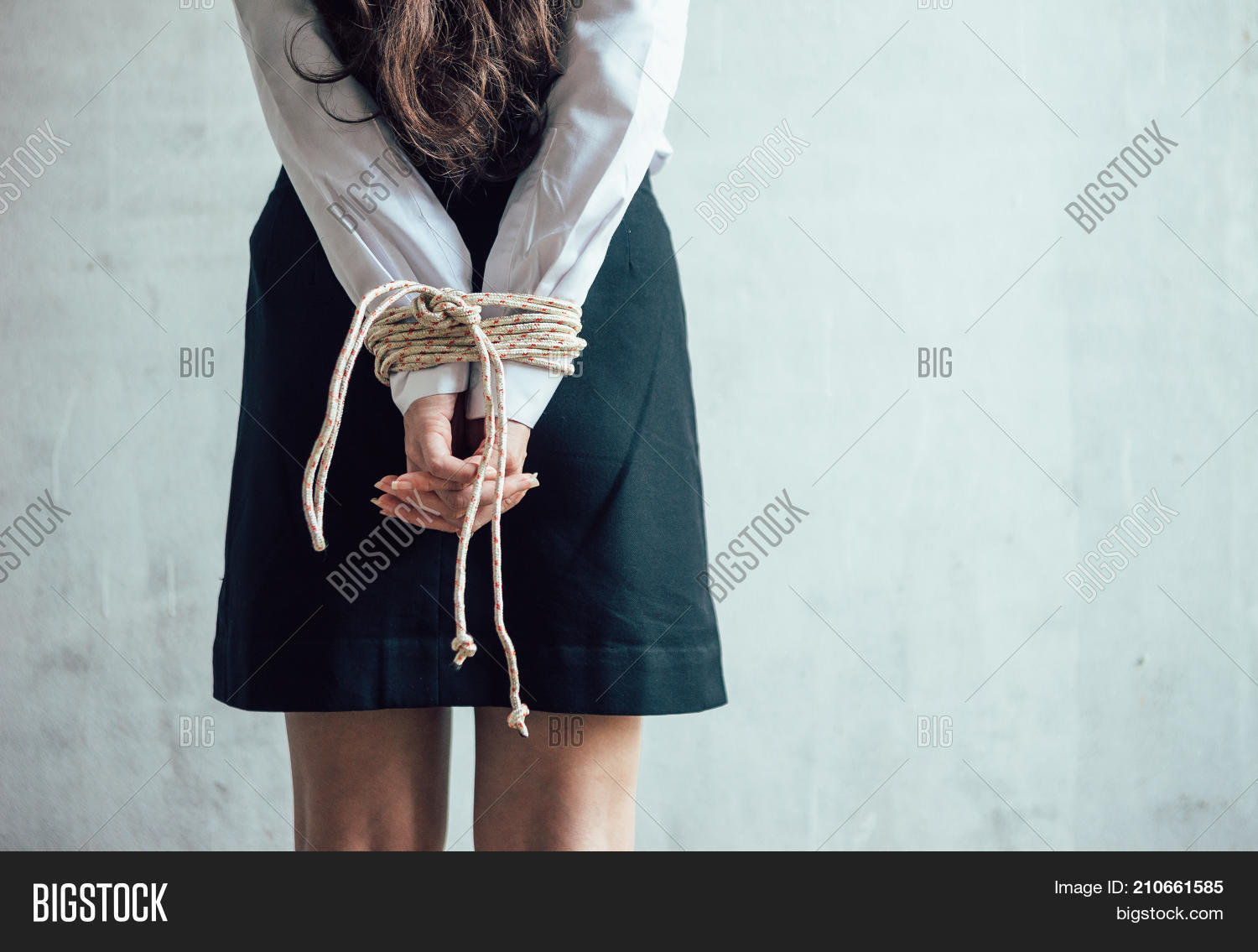 Bound to pole with rope