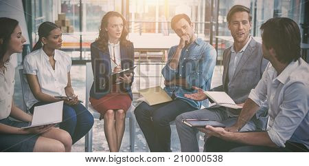 Business executives discussing during meeting at office