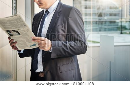 Businessman reading the financial news