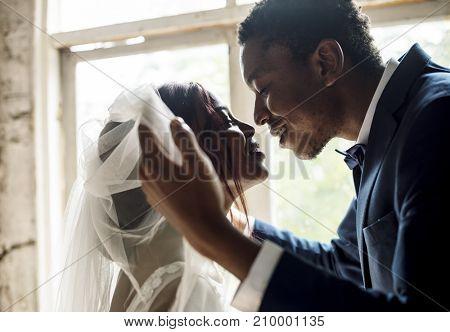 Newlywed African Descent Groom Open Bride Veil Wedding Celebration