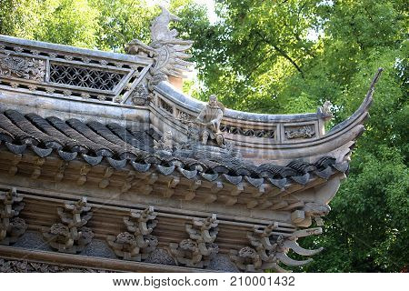Yuyuan Garden pavilion in Shanghai showing the roof detail and decoration.