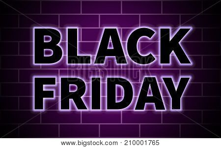 Black Friday illuminated black inscription on the background of a brick wall with a purple glow