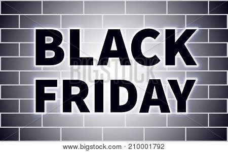 Black Friday black inscription with white glow on a black brick wall background