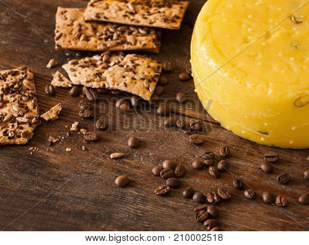 Food composition of gourmet cheese, top view free space. Quality sort of Caciotta with cookies and coffee seed, delicious breakfast concept. Dairy local industry