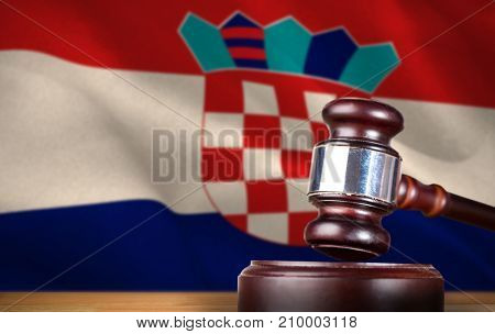 Hammer and gavel against 3d digitally generated croatian national flag