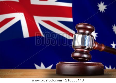 Hammer and gavel against 3d digitally generated australian national flag