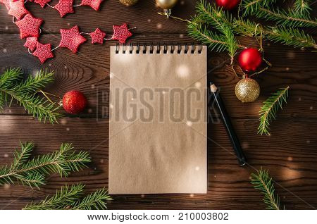 Empty Craft Page Of Spiral Notebook And Christmas Decoration On A Wooden Background. Flat Lay.