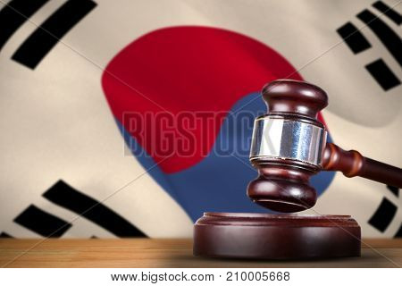 Hammer and gavel against 3d korea republic flag waving