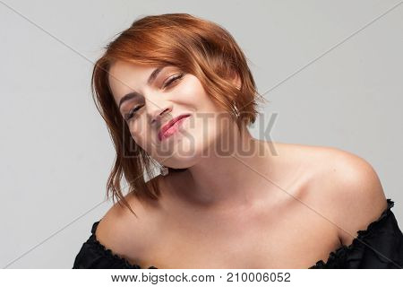 Contempt for life. Overconfident woman. Contemptuous attitude for partner, self-confident young female on grey background closeup