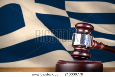 Hammer and gavel against 3d digitally generated greek national flag