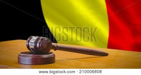 Hammer and gavel against 3d against digitally generated belgian national flag