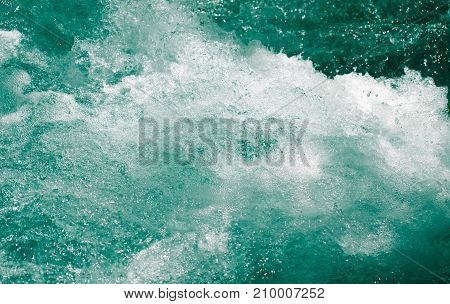 whitewater waves as background . Photo of an abstract texture