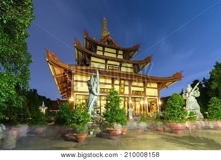 Ho Chi Minh City, Vietnam - September 5th, 2017: Architecture temple at night when lights flickered as glorified spiritual beauty. A peacefull place to calm mind and soul in Ho Chi Minh city, Vietnam