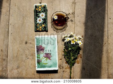 Aerial view of tea cup with flowers decoration