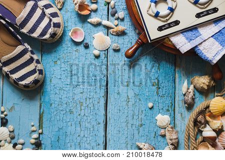Striped Slippers, Camera And Maritime Decorations On The Wooden Background