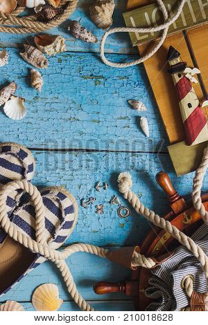 Striped Slippers, Bag And Maritime Decorations On The Wooden Background