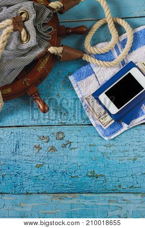 Striped Bag, Phone And Maritime Decorations On The Wooden Background