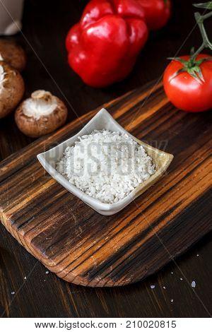 Beautiful white rice in a white ceramic bowl