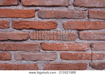 Vintage red brick wall. Grunge background to interior design.