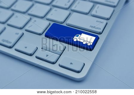 Truck flat icon on modern computer keyboard button Business transportation service concept