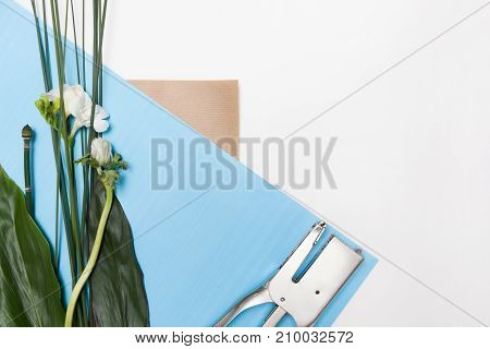 Floral composition of professional arranging, top view and free space. Floristics art and workshop, presents and decoration concept