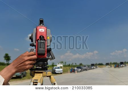 Modern surveyor equipment theodolite or tacheometer used in surveying and building construction for precise measurement. Total station outdoor at construction site. Copy space