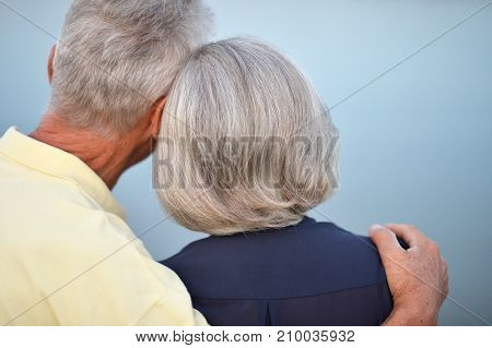 Rear view of senior couple hugging outdoor