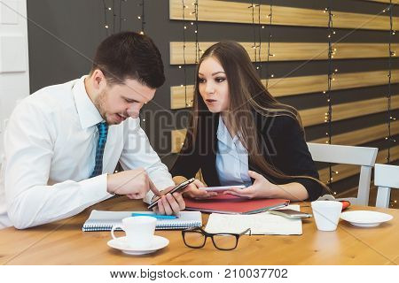 Young girl and boyfriend work hard in the office on an important project