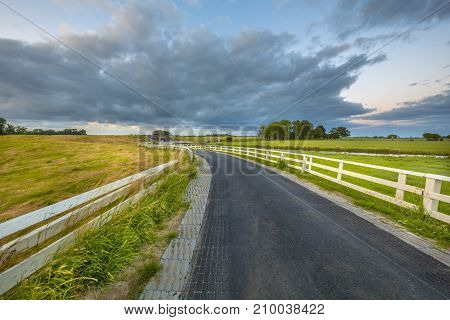 Curved Asphalt Country Road In Dutch Countryside