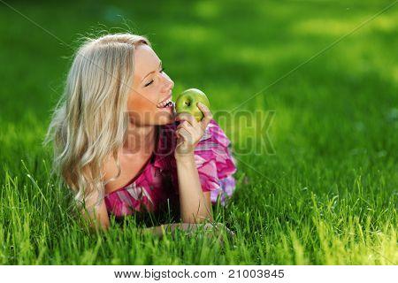 lying on green grass