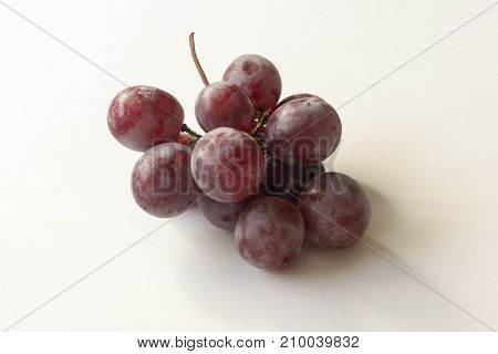 A Bunch Of Grapes On A Background Of A White Color