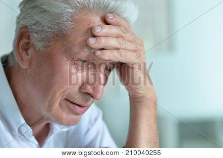 Portrait of Sad senior man at home