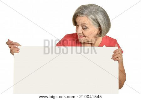 Portrait of an elderly woman in a red dress showing blank card  on a white background