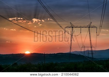 Electricity power line in a beautiful sunset