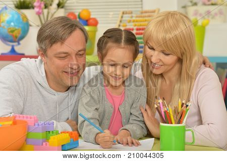 Portrait of happy family painting at home