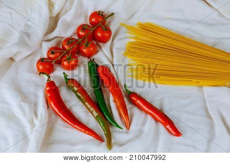 Raw Pasta And Ingredients With Tomatoes,
