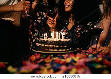 Cropped shot of a woman celebrating birthday indoors