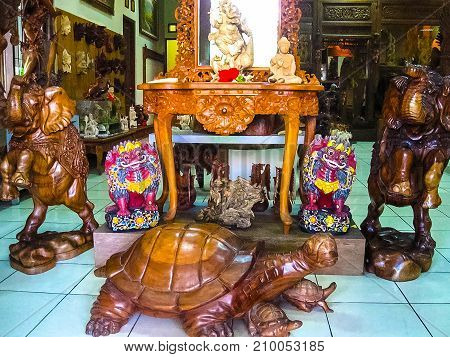 Ubud, Indonesia - April 12, 2012: Carved wooden animal statue in shop at Ubud, Indonesia