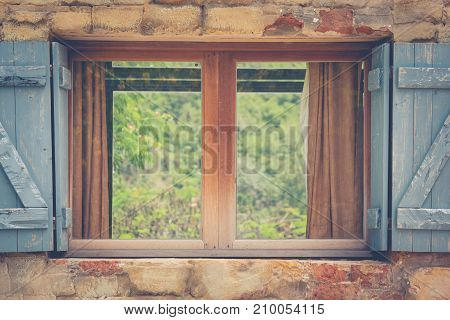 Close up vintage retro opened window with green natural background.