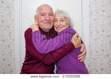 The happy senior couple at home indoor