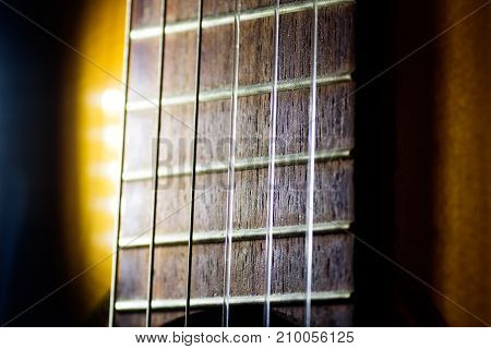 Nylon strings on the acoustic guitar of a musician macro close up
