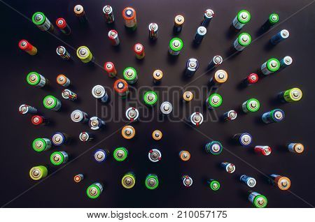 Electric batteries and accumulators size AAA AA. Battery on a black background.