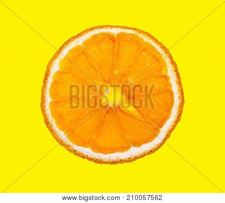 Dry slice of orange isolated on yellow background