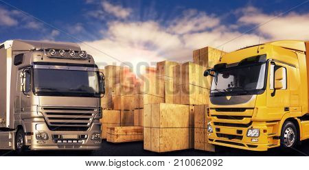 Two modern trucks and many transport boxes in front of evening sky