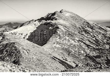 Footpath leading up the peak Dumbier Low Tatras Slovak republic. Hiking theme. Mountains scene. Black and white photo.